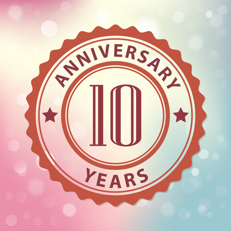 10 Years Anniversary  - Retro style seal, with colorful bokeh background