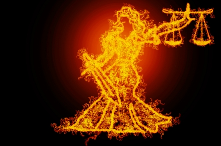 burning lady of justice on fire with black background photo