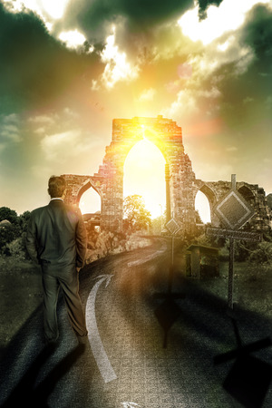 crevice: businessman looking at distance future or prospect with bright sun and path ahead