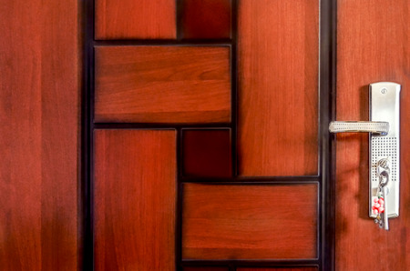 abstract unique wooden pattern door with handle lock photo