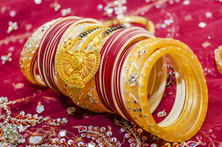 Indian wedding day accessories bangles rings  and gold  jewellery  photo