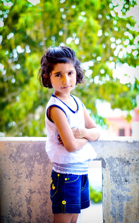 indian asian girl child standing againt bokeh  photo