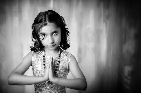 folded hands: portrait of asian indian girl child folded hands welcoming namaste