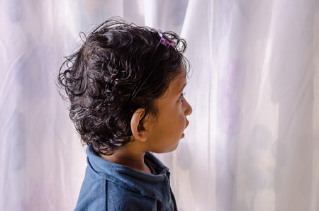 looking sideways: Portrait of small curious child looking sideways Stock Photo
