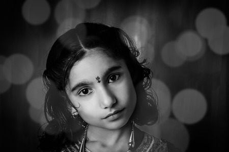 fashion model indian asian girl child closeup portrait with slight makeup and hairstyle and tribal girl style tatoo on face and neck shot with 18-55mm on Nikon D-5100 in studio