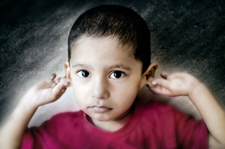 saying: little child saying sorry child holding ears