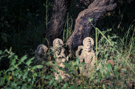 idols: the idol or statues of abandoned lords Laxmi & Ganesh in the bushes under tree in forest or jungle or woods