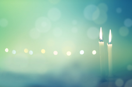 candle lights: Two candles in dark night with bokeh background Stock Photo