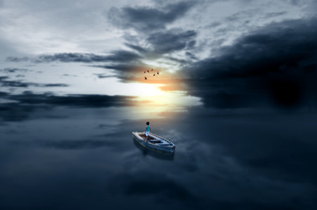 Journey towards light child in boat in waterscape sea surreal magical scene