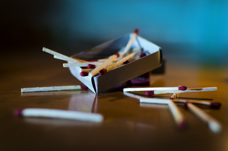 match box: Match box and match sticks lying on floor macro shot indoor in dark depicting concept idea Stock Photo