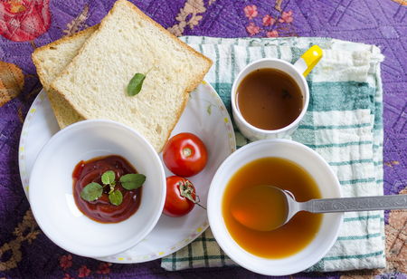 raw tea: healthy raw vegetables tomatoes soup with green black tea