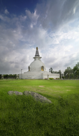 gautama: shanti stupa new delhi india landscape building with cloudy sky Stock Photo