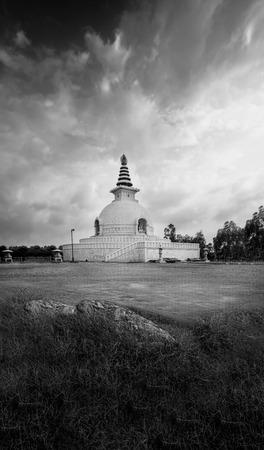 shanti: shanti stupa new delhi india landscape building with cloudy sky Stock Photo