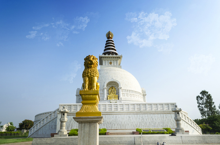 shanti: Peace statue shanti stupa new delhi India with dramatic sky front view