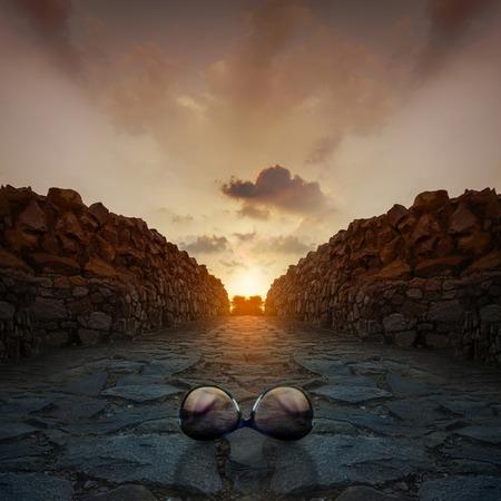 Sunglasses on rocks at beautiful Sunset sunrise at Qutub Minar New Delhi india