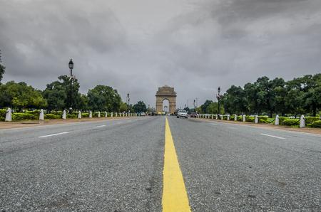 india gate: India Gate new delhi india dramatic cloudy sky