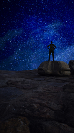 achievment: Reach for the Stars Man standing on rock against galaxy starry sky astro galaxy shot