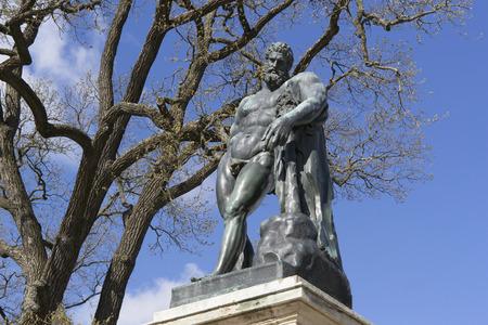 hercules: bronze statue of Hercules in the park Editorial