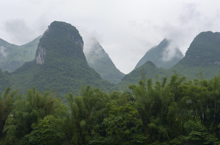 calcareous: cloudy calcareous mountains and rainforest near River Lee, China