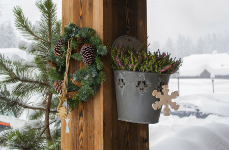 stock photo the rural house with christmas decorations on a wooden column - Christmas Column Decorations