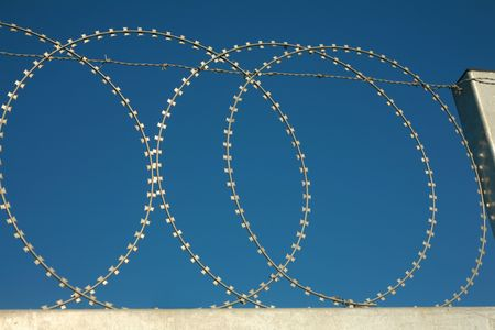 barbed wire fence on a dark blue sky background Stock Photo - 1797566