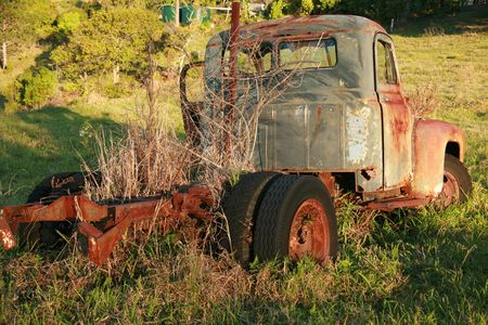 corroding: abandoned old rusted truck front Stock Photo
