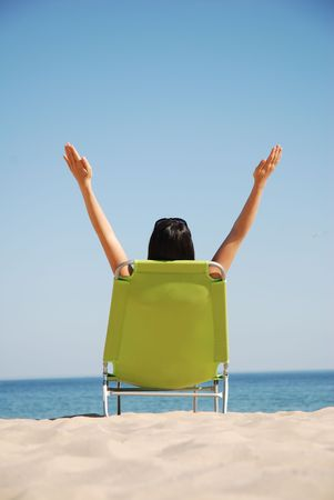 Woman enjoying the sun on deck chair Stock Photo