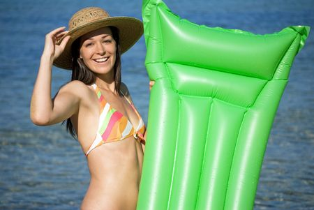 Happy woman with lilo Stock Photo - 5314314