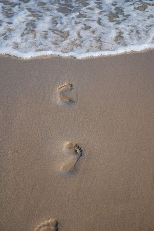 footprints leading to the sea