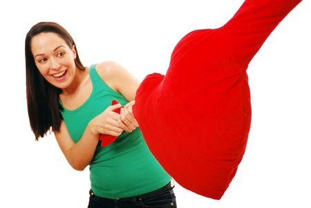 Woman pulling a tug of love Standard-Bild