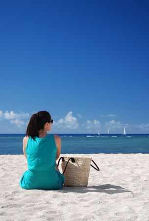 A woman relaxing on the beach Stock Photo