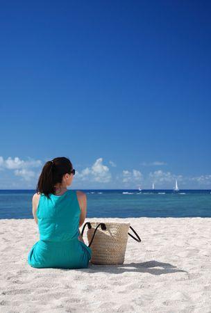 A woman relaxing on the beach Standard-Bild