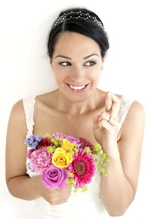 Smiling bride with fingers crossed