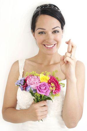 Bride with fingers crossed  Standard-Bild