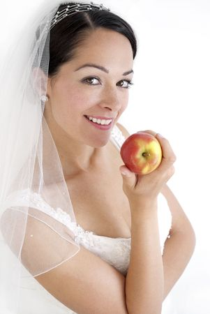Bride to be holding an apple on a calorie controlled diet