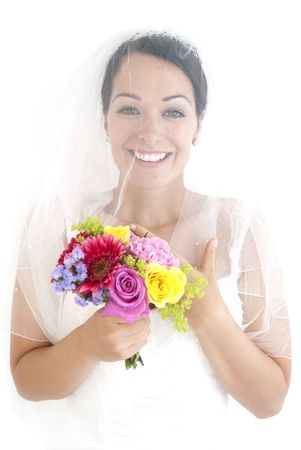 Beautiful bride holding posy of flowers