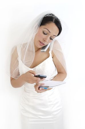 organising: Planning the wedding holding calculator mobile phone and notepad