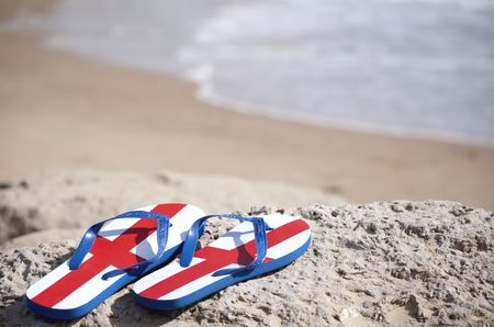 Beach scene with flip flops showing the Cross of St George Stock Photo - 7815231