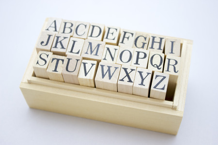 r p m: Alphabet into the wooden box Stock Photo