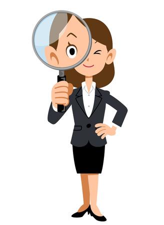 돋보기 아래에있는 회사에서 일하는 여성