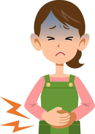 病気の女性の腹部の痛み上