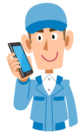 Blue working clothes male conversing on mobile phone