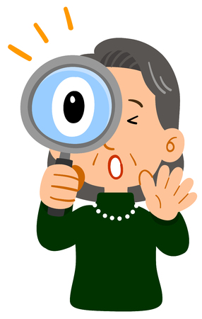 Middle-aged woman's upper body, elegant senior, surprised at looking through the magnifying glass