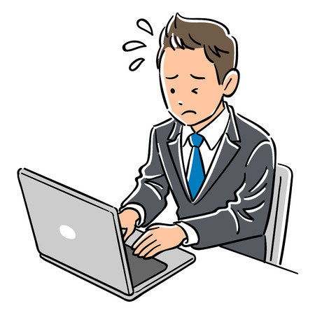 Man in a suit operating a laptop, impatience