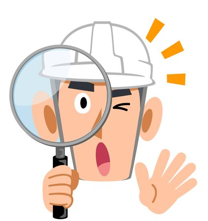 Man wearing a helmet, surprised builder looking through a magnifying glass