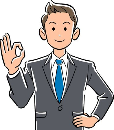Upper body of young business man giving OK sign with hand