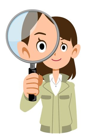 A woman wearing work clothes looking through a magnifying glass