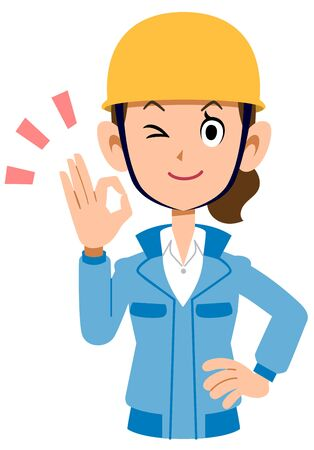 Woman in blue work clothes wearing a helmet giving an OK sign