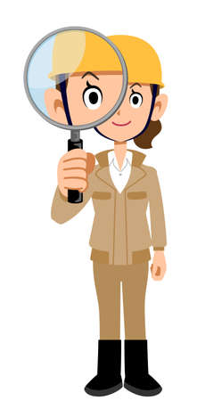 Woman in work clothes wearing a helmet looking through a magnifying glass