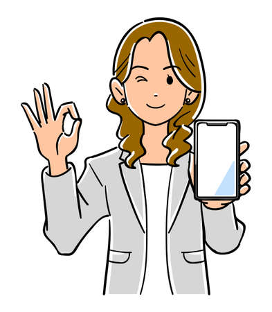 A woman in a suit holding a smartphone and giving an OK sign
